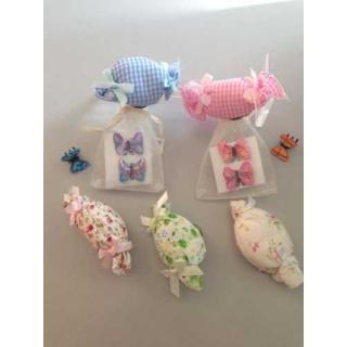bolsa de organza a elegir con broche y dos broches de mariposa
