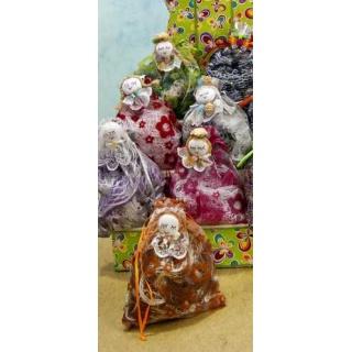 Pashmina en bolsa con broche muñeca surtido